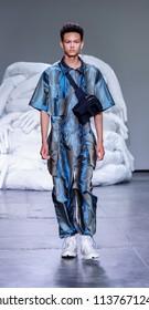 New York, NY, USA - July 10, 2018: A model walks runway for Feng Chen Wang Spring/Summer 2019 runway show during NY Fashion Wweek: Men's at Industria Studios, Manhattan