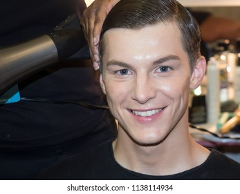 New York, NY, USA - July 9, 2018: A model prepares backstage for Carlos Campos Spring/Summer 2019 collection during NY Fashion Week: Men's at Industria Studios, Manhattan