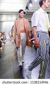 New York, NY, USA - July 9, 2018: Models walk runway for Carlos Campos Spring/Summer 2019 collection during NY Fashion Week: Men's at Industria Studios, Manhattan