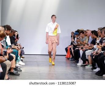 New York, NY, USA - July 9, 2018: A model walks runway for Carlos Campos Spring/Summer 2019 collection during NY Fashion Week: Men's at Industria Studios, Manhattan