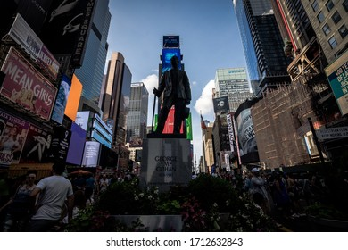 New York, NY / USA - July 20, 2019: Times Square statue depicting composer, playwright, producer and actor George M. Cohan