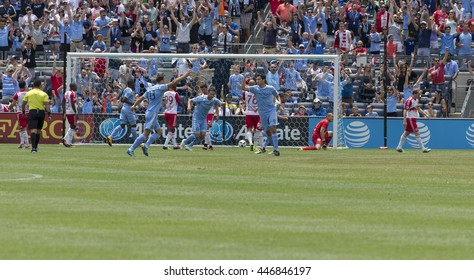 New York, NY USA - July 3, 2016: NYC FC players celebrate goal by Jack Harrison during MLS soccer game against New York Red Bulls at Yankee stadium NYC FC won 2 - 0