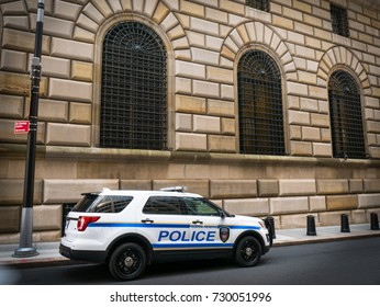 NEW YORK, NY, USA - JULY 19, 2017: Police security vehicle parked outside the Federal Reserve Bank of New York. The building hosts a vault containing the world's largest depository of gold.
