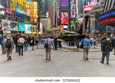 New York, NY, USA -- June 8, 2015. New Yorkers and tourists walk through a pedestrian plaza in midtown near Times Square.