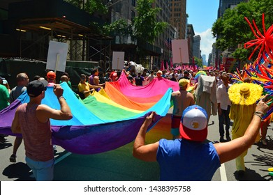 New York, NY, USA June 30, 2019 Marchers carry a large pride flag through the streets of New York as they participate in the World Pride Parade