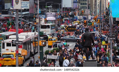 New York, NY, USA. June 18, 2019. Close up of thousands of people walking in Time Square, Broadway and on the seventh Avenue. Aerial view