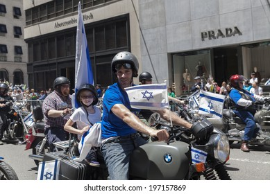New York, NY USA - June 01, 2014: Father and daughter ride motorcycle during 50th annual Israeli Day parade on 5th Avenue in Manhattan