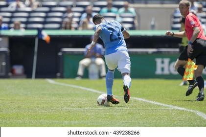 New York, NY USA - June 18, 2016: Ronald Matarrita (22) of NYC FC controls ball during MLS game against Philadelphia Union on Yankee Stadium  NYC FC won 3 - 2