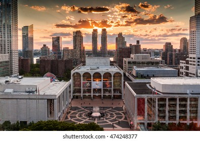 New York, NY, USA - June 22,2016: View the Metropolitan Opera House, located on the Upper West Side of Manhattan in New York City  with the highrise buildings and sunset in the background.