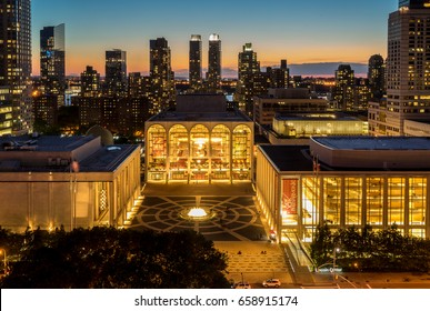 New York, NY USA - June 1, 2017. Sunset view of Lincoln Center Opera House and New York City skyline.