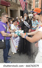 New York, NY USA - June 25, 2017: Member of Marble Collegiate Church distribute drinking water during 48th annual Pride parade along 5th avenue in New York