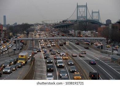 New York, NY, USA - March 1, 2018: Evening rush hour traffic at Queens-bound lanes of the Grand Central Parkway coming off the Robert F. Kennedy (Triborough) suspension bridge.