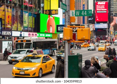 NEW YORK, NY / USA - March 10, 2018: Street corner with traffic in Times Square.