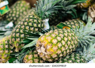 NEW YORK, NY / USA - March 11, 2018: Pineapples in a supermarket.