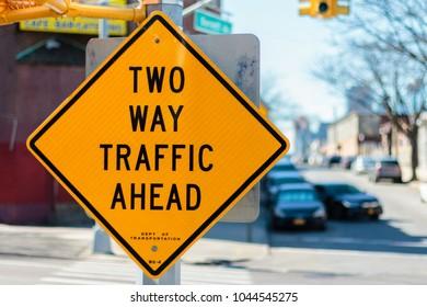 NEW YORK, NY / USA - March 11, 2018: Yellow warning sign.