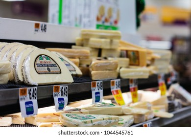 NEW YORK, NY / USA - March 11, 2018: Cheese products on display at a supermarket.