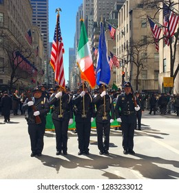 New York, NY, USA March 17, 2017 State troopers March in the New York City St Patrick's Day Parade, carrying the American and Irish flags