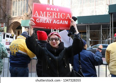 """New York, NY / USA - March 23, 2019: Supporters of President Trump rallied in front of Trump Tower in Manhattan today to celebrate the release of the Mueller report, declaring it """"No Collusion Day""""."""