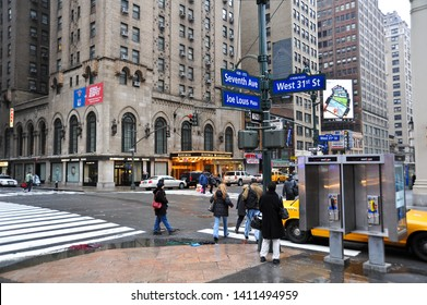 New York, NY / USA - MARCH 14 2010: A rainy day at Joe Louis Plaza, at the corner of Seventh Ave and West 31 St across from Affinia Hotel in midtown Manhattan.