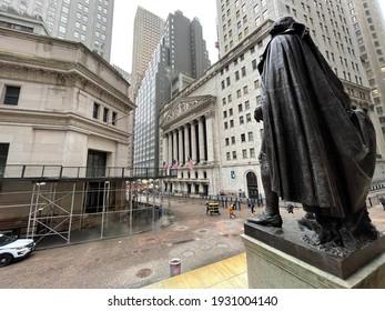 New York, NY  USA - March 1, 2021: New York City, Wall Street and Statue of George Washington
