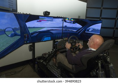 New York, NY USA - March 22, 2016: Unidentified man enjoys BMW M racing simulator during BMW preview party celebrating company 100 years at New York International autoshow at Highline Stages