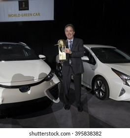 New York, NY USA - March 24, 2016: William Fay holds best 2016 green car for Toyota Mirai at New York International Auto Show at Jacob Javits Center