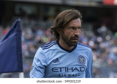 New York, NY USA - March 12, 2017: Andrea Pirlo (21) of NYCFC hits corner during MLS game against DC United on Yankee stadium