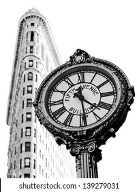 NEW YORK, NY, USA - MAY 6: Flat Iron building, built in 1902 is of the first skyscrapers ever built and one of New York's famous sidewalk clocks on May 6, 2012 in New York City, United States.