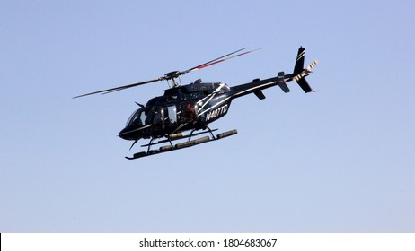 New York, NY, USA - May 1, 2013: 2007 BELL HELICOPTER TEXTRON CANADA 407, Registration N407TD, seen over Downtown Heliport