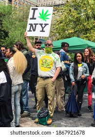 New York, NY USA - May 4, 2019:  A person holds a sign that says I love New York with a marijuana leaf replacing heart symbol, at a cannabis rally at Union Square on May 4, 2019 in New York, NY.
