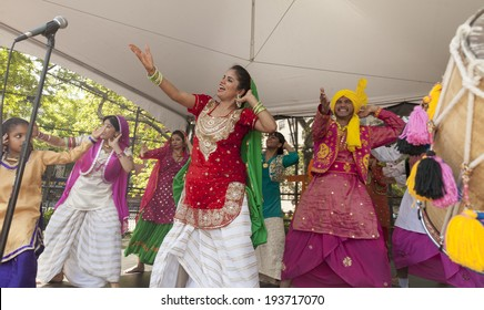 New York, NY USA - May 17, 2014: Indian NYC Bhangra dance group performs on 8th annual dance parade on stage at Tompkins park