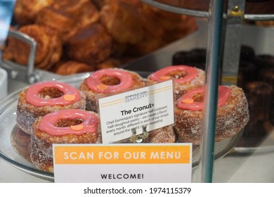 New York, NY  USA - May 12, 2021: Dominique Ansel Bakery's signature cronuts on display. DKA in bokeh in the back.