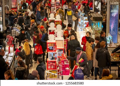 New York NY/ USA- November 23, 2018 Hordes of shoppers throng the Macy's Herald Square flagship store in New York looking for bargains on the day after Thanksgiving, Black Friday.