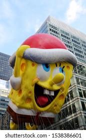 New York, NY / USA - November 26, 2015: The SpongeBob SquarePants balloon floats among New York City's skyscrapers during the annual Macy's Thanksgiving Day parade.