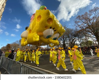 New York, NY / USA - November 28 2019: SpongeBob SquarePants & Gary balloon on Central Park West in the 93rd Annual Macy's Thanksgiving Day Parade