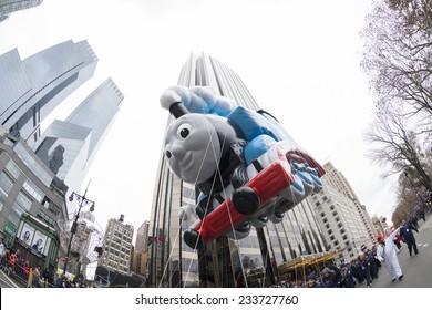 New York, NY USA - November 27, 2014: Thomas the Tank Engine balloon is flown at the 88th Annual Macy's Thanksgiving Day Parade along Columbus Circle