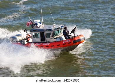 NEW YORK, NY, USA - NOVEMBER 21, 2012: United States Coast Guard boat steaming through the water of New York Harbor in New York, NY, USA on November 21, 2012.