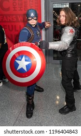 New York, NY, USA - October 4, 2018: Comic Con attendees pose in the costumes during Comic Con 2018 at The Jacob K. Javits Convention Center in New York City.
