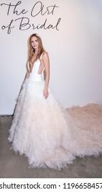 New York, NY, USA - October 6, 2018: Model shows up dresses for Atelier Pronovians 2019 Presentation during New York Bridal Week at Studio 525, Manhattan.