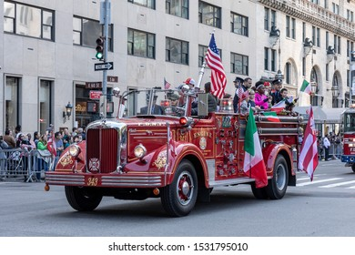 New York, NY, USA - October 14, 2019: Historical Fire Department truck moves along Fifth Avenue during 75th Annual Columbus Day Parade, Manhattan.