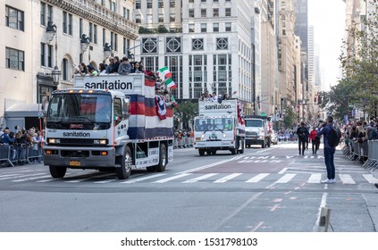 New York, NY, USA - October 14, 2019: Sanitation trucks moves along Fifth Avenue during 75th Annual Columbus Day Parade, Manhattan.
