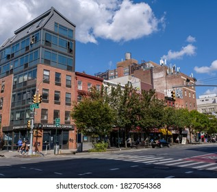 New York, NY / USA - October 4 2020: Exterior of a Starbucks and other stores on the corner of 13th Street and 1st Avenue in the East Village, New York City