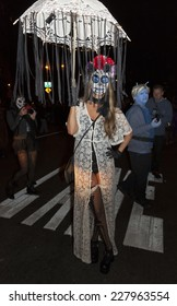 New York, NY USA - October 31, 2014: Atmosphere at Halloween Parade with the theme The Garden of Earthly Delights in West Village