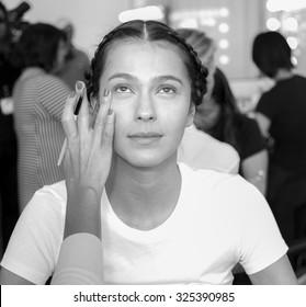 New York, NY, USA - October 8, 2015: A model prepares backstage for Marchesa Fall/Winter 2016 Bridal Presentation at Canoe Studio, Manhattan