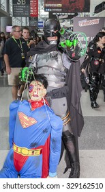 New York, NY, USA - October 9, 2015: Comic Con attendees pose in the costumes during Comic Con 2015 at The Jacob K. Javits Convention Center in New York City.