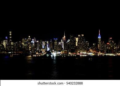 New York, NY, USA - October 7, 2016: Manhattan Skyline: Manhattan Skyline from New Jersey through Hudson River in night