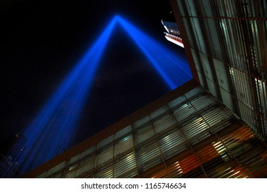 New York, NY, USA - September 11, 2016: The annual Tribute in Light soars into the night sky above downtown Manhattan from the roof of a parking garage.