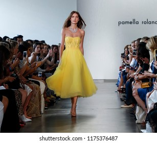 New York, NY, USA - September 6, 2018: A model walks runway for the Pamella Roland Spring/Summer 2019 collection during New York Fashion Week at Pier 59 Studuos, Manhattan