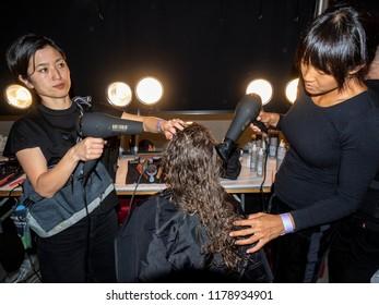New York, NY, USA - September 9, 2018: A model prepares backstage for the Prabal Gurung Spring/Summer 2019 runway show during New York Fashion Week at Spring Studios, Manhattan