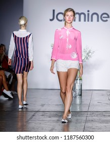 New York, NY, USA - September 8, 2018: A model walks runway to present Jasmine by Jane Qin Spring/Summer 2019 collection during New York Fashion Week at Industria Studios, Manhattan